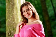 Young woman closeup portrait near tree Royalty Free Stock Image