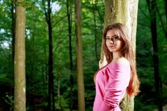 Young woman closeup portrait near tree Stock Images