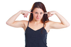 Young woman closing ears with fingers Royalty Free Stock Image