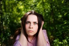 Young woman closing ears. Ugly noise concept Royalty Free Stock Photos