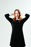 Young woman closing her ears and screaming Stock Image