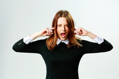 Young woman closing her ears and screaming Royalty Free Stock Images