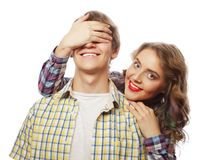 Young woman closing his boyfriend eyes. Stock Photography