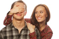 Young woman closing his boyfriend eyes. Royalty Free Stock Photography