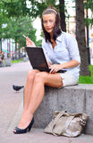 Young woman is closing laptop Royalty Free Stock Photos