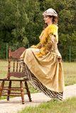 The young woman in clothes of 18 centuries Stock Images