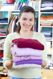 Young woman with clothes Stock Image