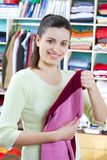 Young woman with clothes Stock Photography