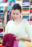 Young woman with clothes Stock Images