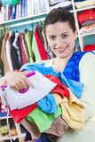Young woman with clothes Royalty Free Stock Photography