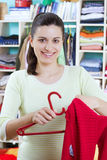 Young woman with clothes Royalty Free Stock Photos