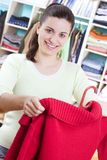Young woman with clothes Royalty Free Stock Images