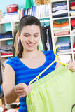 Young woman with clothes Stock Photo