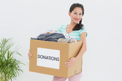 Young woman with clothes donation Royalty Free Stock Images