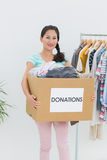 Young woman with clothes donation Stock Photography