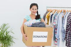 Young woman with clothes donation Royalty Free Stock Image