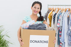 Young woman with clothes donation Stock Photo