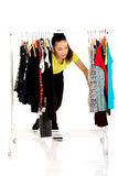 Young woman with clothes on hanger. Stock Photography