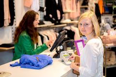 Young woman in the clothes shop Royalty Free Stock Image