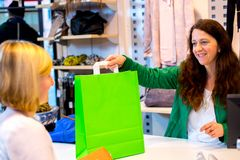 Young woman in the clothes shop Royalty Free Stock Photography