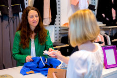 Young woman in the clothes shop Royalty Free Stock Photo