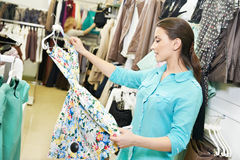 Young woman at clothes shopping Royalty Free Stock Images