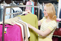 Young woman at clothes shopping store Royalty Free Stock Photos