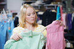 Young woman at clothes shopping store Stock Photography