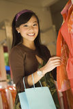Young Woman In Clothes Store Royalty Free Stock Images