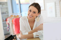 Young woman in the clothing store Stock Photos