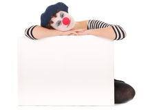 Young Woman Clown Face Holding billboard. Young woman wearing clown face holding billboard isolated on white Stock Photos