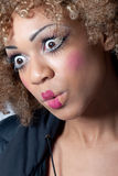 Young woman with clown make-up looking surprised Stock Images