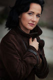 Young woman in coat Stock Photography