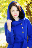 Young woman in a  coat Stock Photography