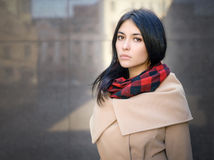 Young woman in a coat Stock Image