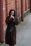 Young woman in coat Royalty Free Stock Photos