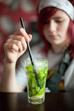 Young woman with a cocktail. Young girl drinking a cocktail with mint Stock Photos