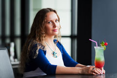 Young woman with a cocktail. Stock Photos