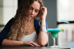 Young woman with a cocktail. Stock Photography