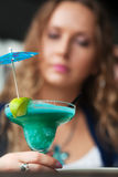 Young woman with cocktail. Royalty Free Stock Images