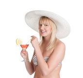 Young woman with cocktail. Pretty young blond woman with cocktail stock image