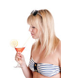 Young woman with cocktail. Pretty young blond woman with cocktail royalty free stock image