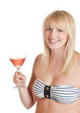 Young woman with cocktail. Pretty young blond woman holding a glas of cocktail royalty free stock images