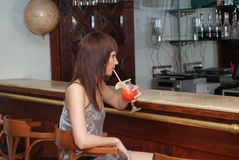 Young woman with cocktail. Beautiful woman in the restaurant Stock Photography