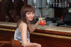 Young woman with cocktail. Beautiful woman in the restaurant Royalty Free Stock Photo