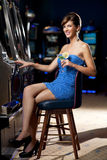 Young woman with cocktail in a casino Royalty Free Stock Photos
