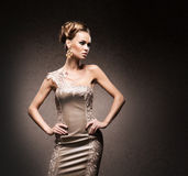 A young woman in a cocktail dress in a studio Royalty Free Stock Photography