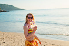 young woman with cocktail relaxing on beach Stock Image