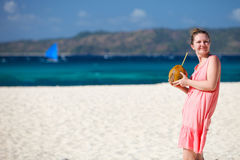 Young woman with coconut Royalty Free Stock Image