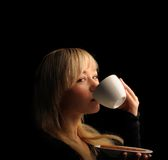 Young  woman with coffe  on a dark background Royalty Free Stock Photography